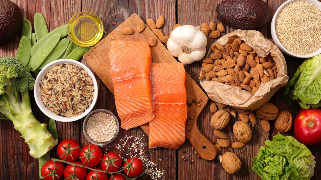Рыба, орехи, овощи, крупы на столе